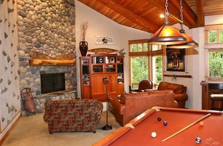 Not just a pool table . . . also climbing wall, gym, media room, wine cellar, and trampoline. What more could one want?