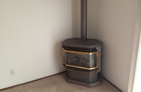 Gas stove efficiently heats the entire house at 61090 via Sandia in Bend