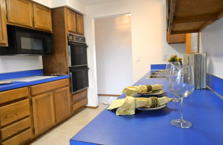 Everybody loves the bright blue counter tops